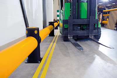 forklift guard rail protects wall from damage