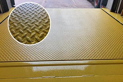 slip reduction coating applied to dock leveler