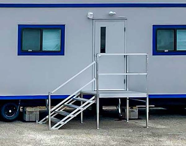 portable stairs at office trailer entrance